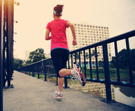 Runner athlete running on iron bridge Stock Photo