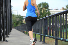 Runner athlete running on iron bridge Stock Photography