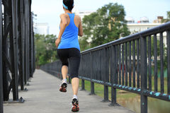 Runner athlete running on iron bridge Royalty Free Stock Image