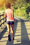 Runner athlete running at park trail Royalty Free Stock Images