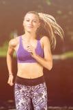 Runner athlete running at park. woman fitness jogging workout wellness concept. Runner athlete running at tropical park. woman fitness jogging workout wellness stock image