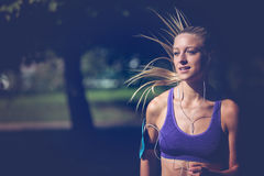 Runner athlete running at park. woman fitness jogging workout wellness concept. Runner athlete running at tropical park. woman fitness jogging workout wellness stock image