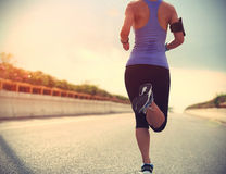 Runner athlete running on road royalty free stock image