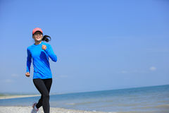 Runner athlete running on seaside of qinghai lake Stock Photo