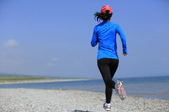 Runner athlete running on seaside of qinghai lake Royalty Free Stock Photography