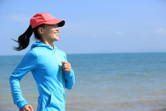 Runner athlete running on seaside of qinghai lake Stock Photography