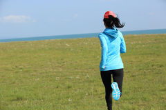 Runner athlete running on seaside of qinghai lake Stock Photos