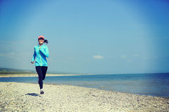 Runner athlete running on seaside of qinghai lake Stock Image