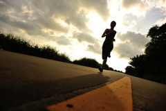 Runner athlete running at seaside road Royalty Free Stock Photo