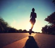 Runner athlete running at seaside road Royalty Free Stock Photos