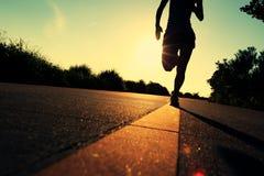 Runner athlete running at seaside road Stock Photo