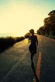 Runner athlete running at seaside road Royalty Free Stock Images