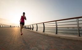 Runner athlete running at seaside royalty free stock photo