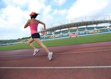 Runner athlete running on stadium Stock Photography