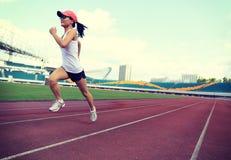 Runner athlete running on stadium Royalty Free Stock Photo