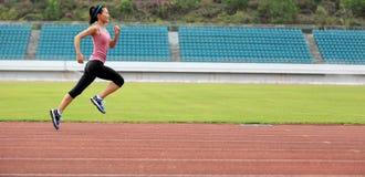 Runner athlete running on stadium Stock Images