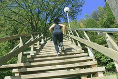 Runner athlete running on stairs. woman fitness Royalty Free Stock Images