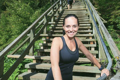 Runner athlete running on stairs. woman fitness Stock Photo