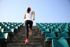 Runner athlete running on stairs royalty free stock photo