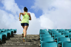 Runner athlete running on stairs Royalty Free Stock Image