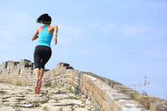 Runner athlete running on trail at chinese great wall Stock Images
