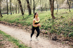 Runner athlete running at tropical park. woman fitness jogging workout wellness concept. stock image