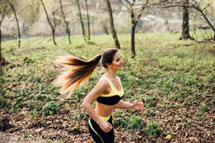 Runner athlete running at tropical park. woman fitness jogging workout wellness concept. Stock Photo