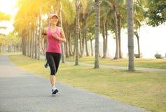 Runner athlete running at tropical park Stock Photo