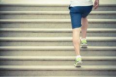 Runner athlete running up the stairs Stock Photo