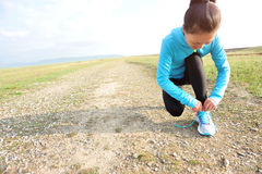 Runner athlete tying shoelace Stock Photos