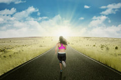 Runner athlete workout on the road Stock Images