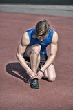 Runner, athletic bearded man with muscular body tie shoe laces Stock Photos