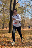 Runner in the autumn forest Royalty Free Stock Image
