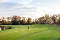 Runner on the autumn park. Golf, garden, care free. Outdoor shot Royalty Free Stock Photography
