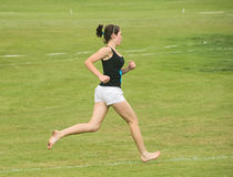 Runner in bare feet at Nairn. Stock Images