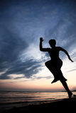 Runner on the beach. At sunset Stock Photos
