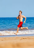 Runner on Beach Stock Image
