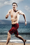 Runner on Beach Stock Photography