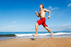 Runner on Beach Stock Photo