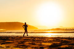 Runner on beach at sunset Royalty Free Stock Photo
