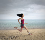 Runner at the beach Royalty Free Stock Photos