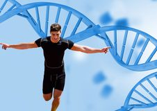 Runner with blue dna chain background. Digital composite of runner with blue dna chain background royalty free stock photo