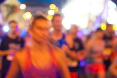 Runner in blurred motion running at competition Royalty Free Stock Images