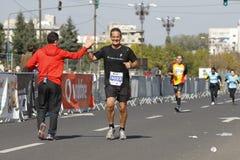 Happy runner at the marathon stock photos