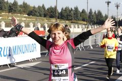 Happy runner at the marathon stock images