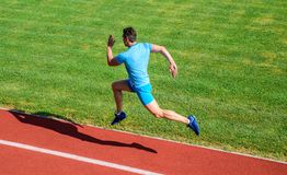 Runner captured in midair. Short distance running challenge. Boost speed. Athlete run track grass background. Run into. Shape. Running challenge for beginners stock photography
