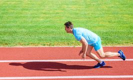Runner captured in motion just after start of race. Boost speed concept. Man athlete runner push off starting position. Stadium path sunny day. How to start stock images