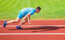 Runner captured in motion just after start of race. Runner sprint race at stadium. How to start running. Boost speed. Concept. Man athlete runner push off royalty free stock photography