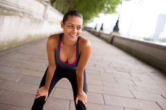 Runner catching her breath Stock Photography