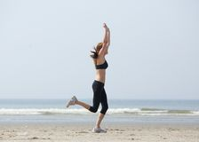 Runner celebrating with arms raised in success Royalty Free Stock Images